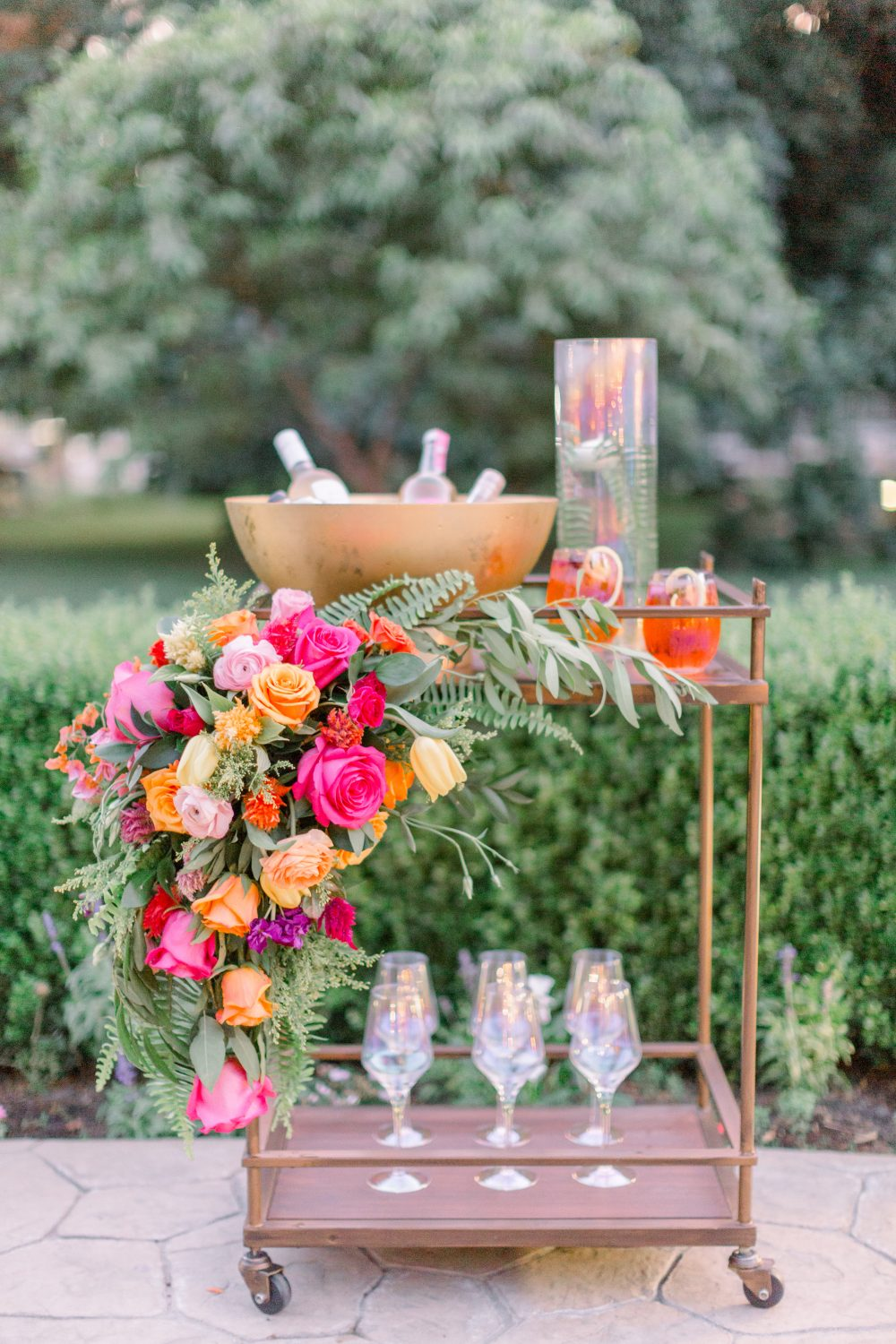 Bright and colorful wedding bar cart with flowers by CH&LER