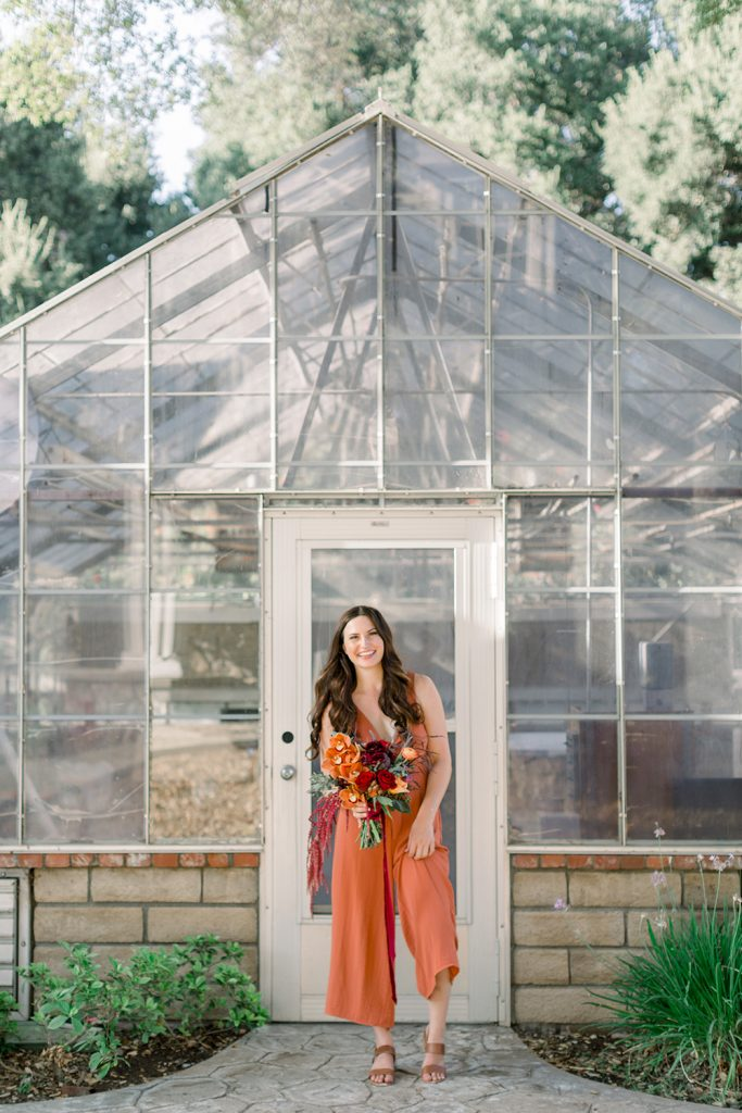 CH&LER Flower House owner in front of greenhouse in Southern California